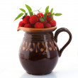 Berry garden hybrid of blackberry and raspberry in a clay jug — Stock Photo