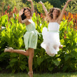 Two girls in summer garden — Stock Photo