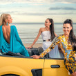 Three girls with sport car — Stok fotoğraf