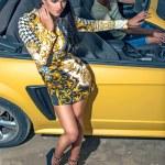 Girl man and sport yellow car — Stock Photo