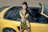 Beautiful girl posing near sport car — Stock Photo