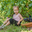The girl with grapes in hands  — Stock Photo