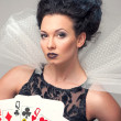 Perfect young woman with playing cards — Stock Photo