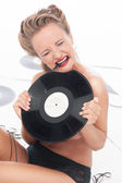 Sexy naked girl covered up with vinyl disc — Stock Photo