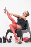 Sexy woman trying on high heeled shoes — Stock Photo