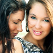 Two smiling attractive girl friends — Stock Photo #37105261