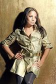 Woman wearing beige jacket and leggins — Stock Photo