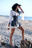 Pirate woman at the beach — Stock Photo