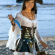 Pirate woman at the beach — Stock Photo #46651475