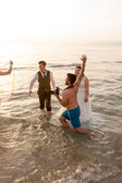 Wedding couple in water — Stock Photo