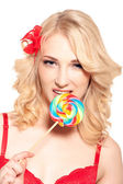 Sexy lady licking a lollipop — Stock Photo