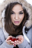 Blurred Christmas woman holding red gifts — Stock Photo