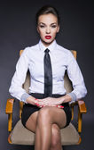 Attractive businesswoman sitting on the chair — Stock Photo