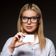 Attractive businesswoman with a blank business card - Stock Photo