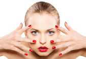 Portrait of attractive woman with red lips and nails — Stock Photo