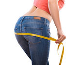 Weight losing - measuring woman's body — Stock Photo