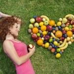 Girl with fruit — Stock Photo #15353507