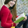 Girl with book — Stock Photo #15356593