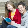 Students with book — Stock Photo