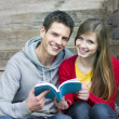 Students with book — Stock Photo #15356631
