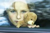 Sad girl in car — Stock Photo