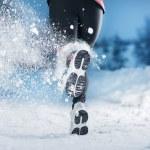 Winter running woman — Stock Photo
