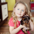 Royalty-Free Stock Photo: Little girl and puppy