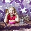 Little girl is eating — Stock Photo