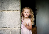 Little girl by the door — Stock Photo