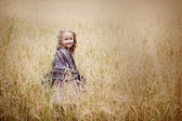 Little girl in the field — Stock Photo