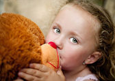 Girl with her teddy — Stock Photo