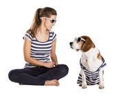 Dog and woman in studio — Stock Photo