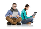Man and woman with tablet — Stock Photo