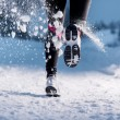 Woman running in winter — ストック写真