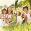 Happy kids with dog — Stock Photo