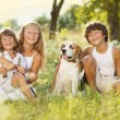 Happy kids with dog — Stock Photo #29226917