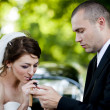 Bride and groom in car — Stock Photo