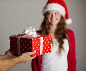 Man handing woman gift — Stock Photo