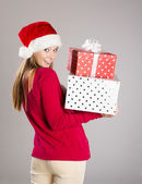 Beautiful christmas woman with gift — Stock Photo