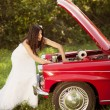 Bride and car — Stock Photo