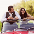 Wedding car with bride and groom — Stock Photo #35291089