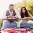 Wedding car with bride and groom — Stock Photo #35293173