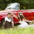 Wedding car with bride and groom — Stock Photo #35301127
