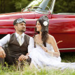 Wedding car with bride and groom — Stock Photo #35302811