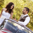 Wedding car with bride and groom — Stock Photo #35304017