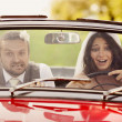 Wedding car with bride and groom — Stock Photo