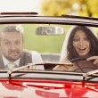 Wedding car with bride and groom — Stok fotoğraf
