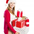 Beautiful christmas woman with gift — Stock fotografie