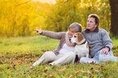 Seniors with dog — Stock Photo