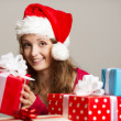 Cute girl with christmas presents — Stock fotografie